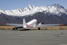 Aircraft photo of N59314 - Douglas C-47A Skytrain - Abbe Air, taken by F Seggie at Palmer - Buddy Woods Municipal (PAAQ / PAQ) in Alaska, United States on 30 April 2009. One of four DC 3s on the ramp at Palmer with the superb scenery of snow covered mountains behind.