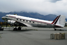 Aircraft photo of N59314 - Douglas C-47A Skytrain - Abbe Air, taken by Ralph M. Pettersen at Palmer - Buddy Woods Municipal (PAAQ / PAQ) in Alaska, United States on 28 September 2005. Very rugged mountains surround the airport at Palmer, AK