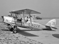 Aircraft photo of G-AOZB / 33 - De Havilland DH.82A Tiger Moth II, taken by Jerry Hughes at Biggin Hill (EGKB / BQH) in England, United Kingdom in 1959.