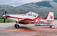 Aircraft photo of C-FXVF - Air Tractor AT-802F - Conair Aviation, taken by Aad van der Voet at Kamloops (CYKA / YKA) in British Columbia, Canada on 4 June 2006. Ready for duty on a retardant-stained apron.